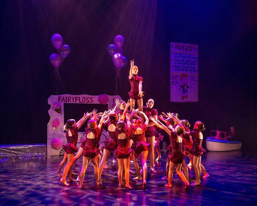 Girls acro dancing human pyramid