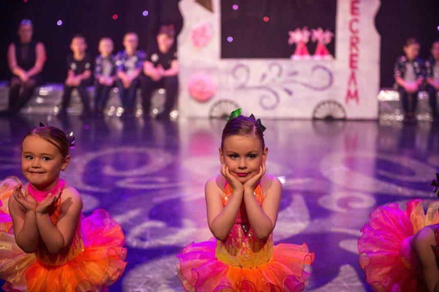 Young ballerina posing head in hands