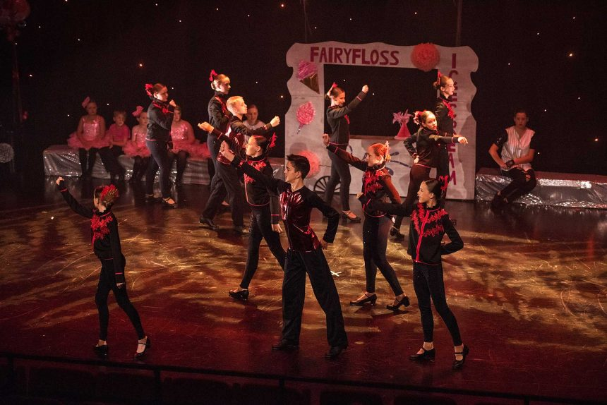 Tap dancers dancing in fire eater costumes