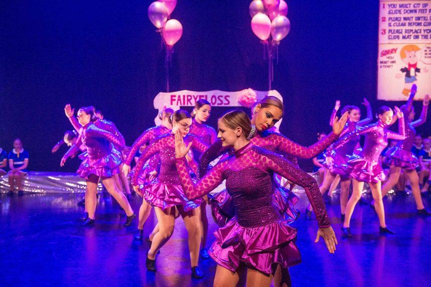 Girls jazz dancing in purple costumes