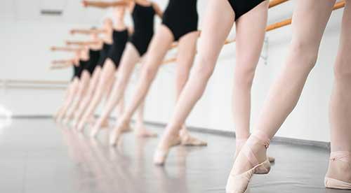 Ballerina feet at ballet barre