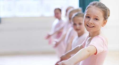 Girl smiling in ballet dance class