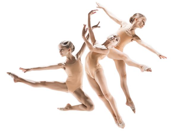 Three ballet dancers jumping