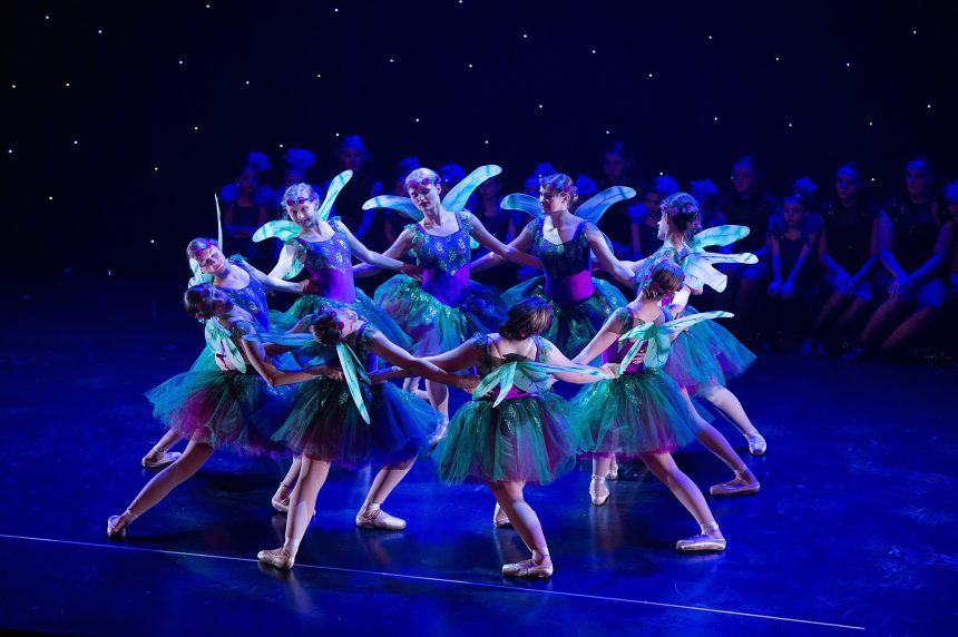 Classical ballerinas in fairy costumes dancing in circle