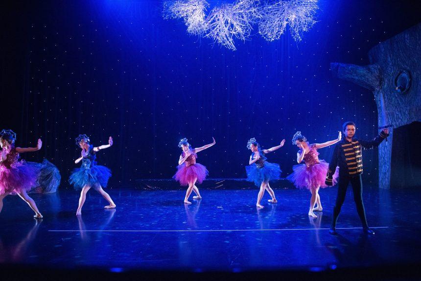 Teen ballet dancers dancing in costume at concert