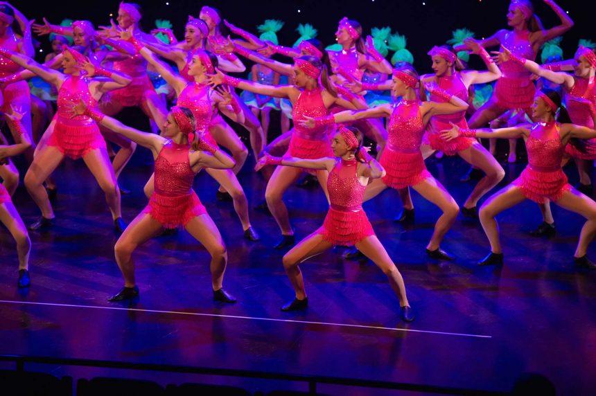 Girls jazz dancing in pink costumes